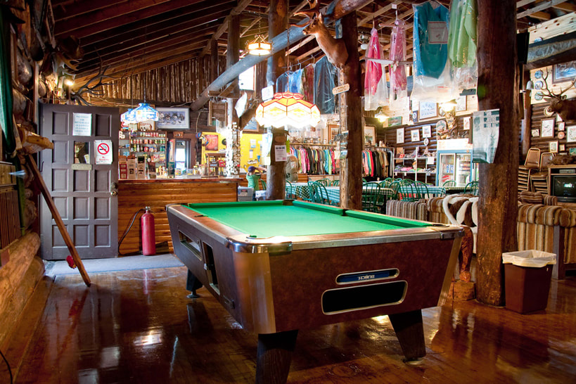 The game area and pool table at Northland Lodge