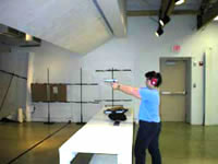individual firing handgun at the Minnesota Shooting Sports Education Center in Grand Rapids